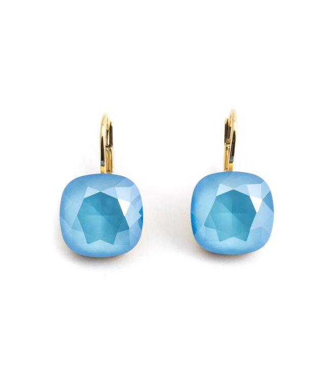 Krikor Vergulde oorbellen met licht blauw Swarovski kristal