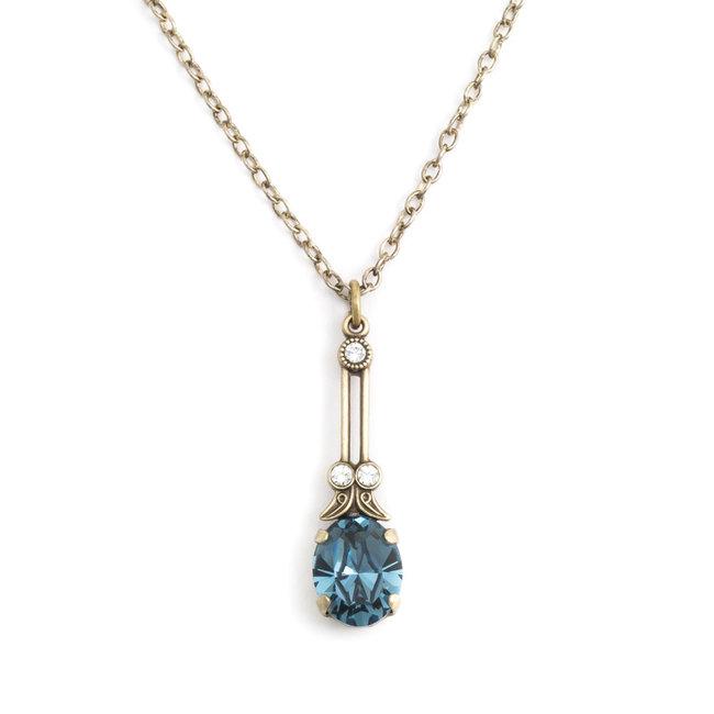 Halsketting met blauw kristal