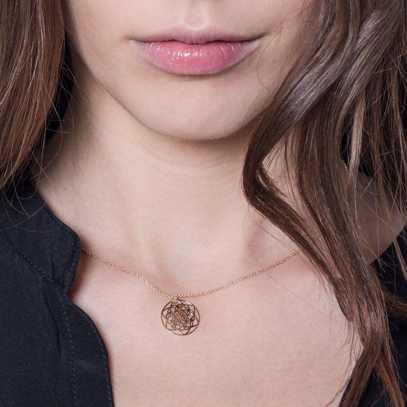 Tiny Om Tiny Flower of life necklace