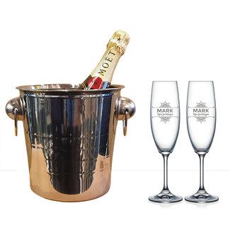 Champagnekoeler met glazen en fles