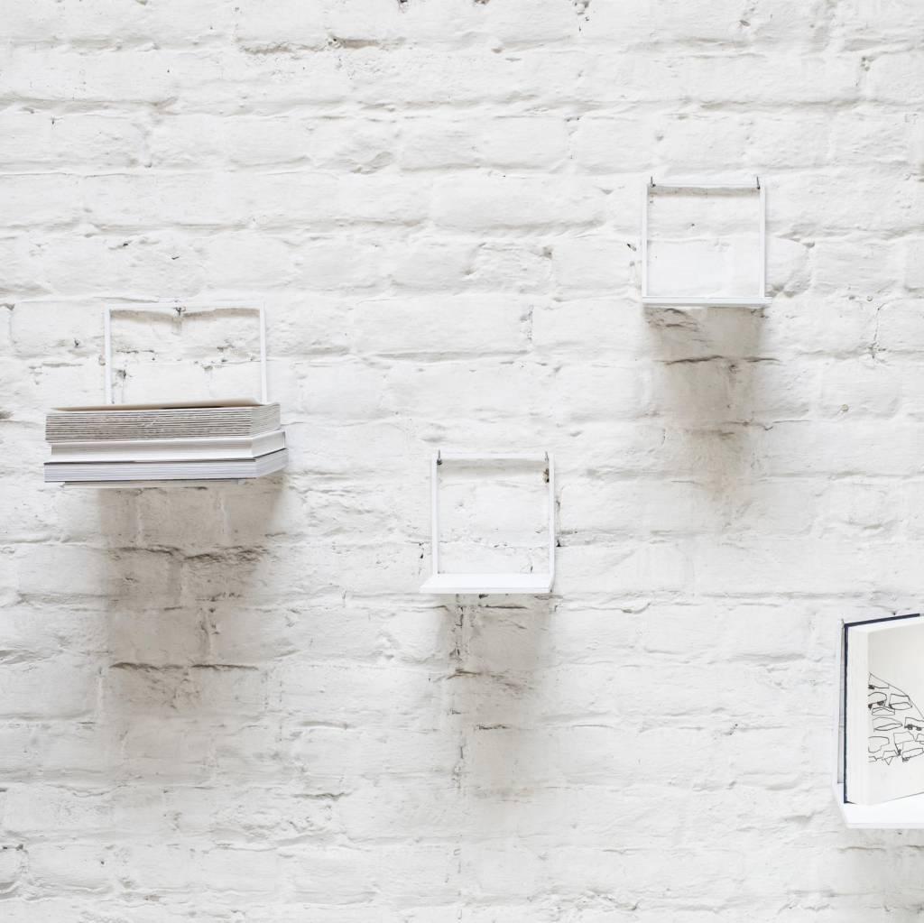 Minimal design metal wall shelf in matte white.