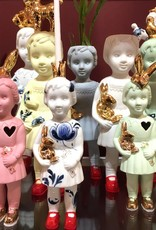 Pink ceramic mini doll by Lammers and Lammers