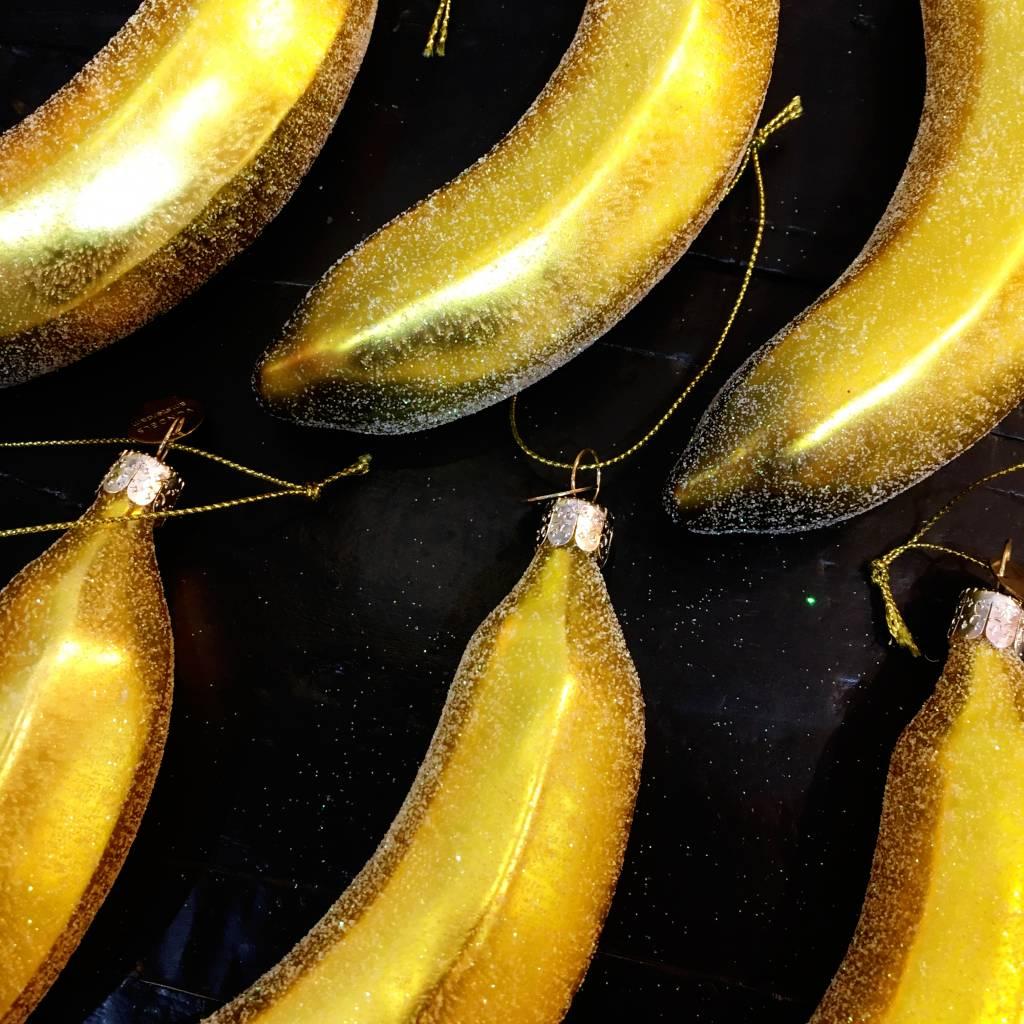 Aparte kersthanger van glas in de vorm van een banaan