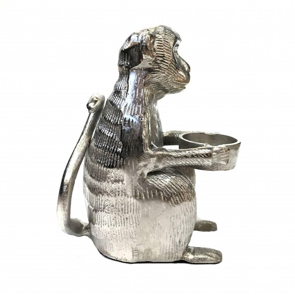 Metalen waxinelichthouder in de vorm van een aap