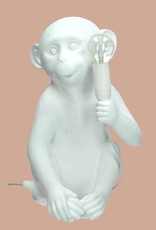 Design tafellamp in de vorm van een wit aapje