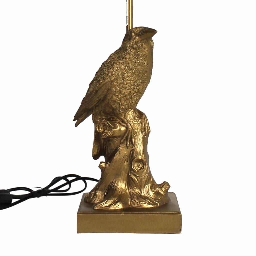 Gold bird lamp in the shape of a crow