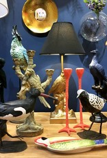 Gouden vogel lamp in de vorm van een kraai