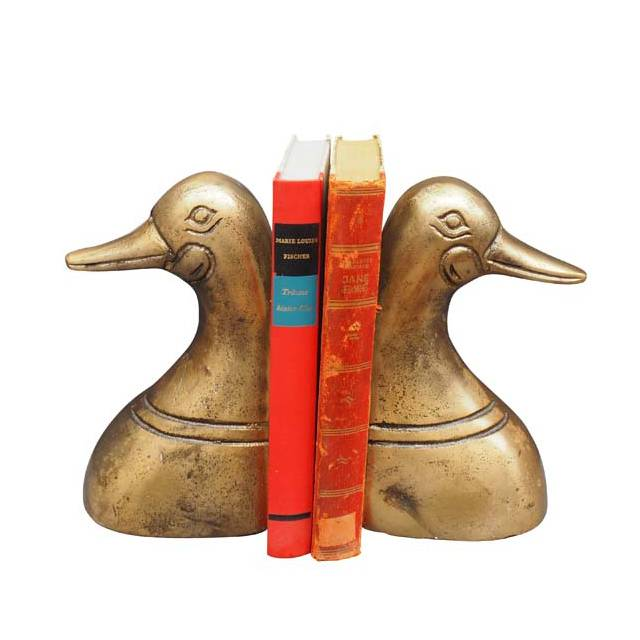 Gold duck heads book ends
