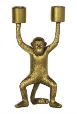 Gouden kandelaar in de vorm van een aapje
