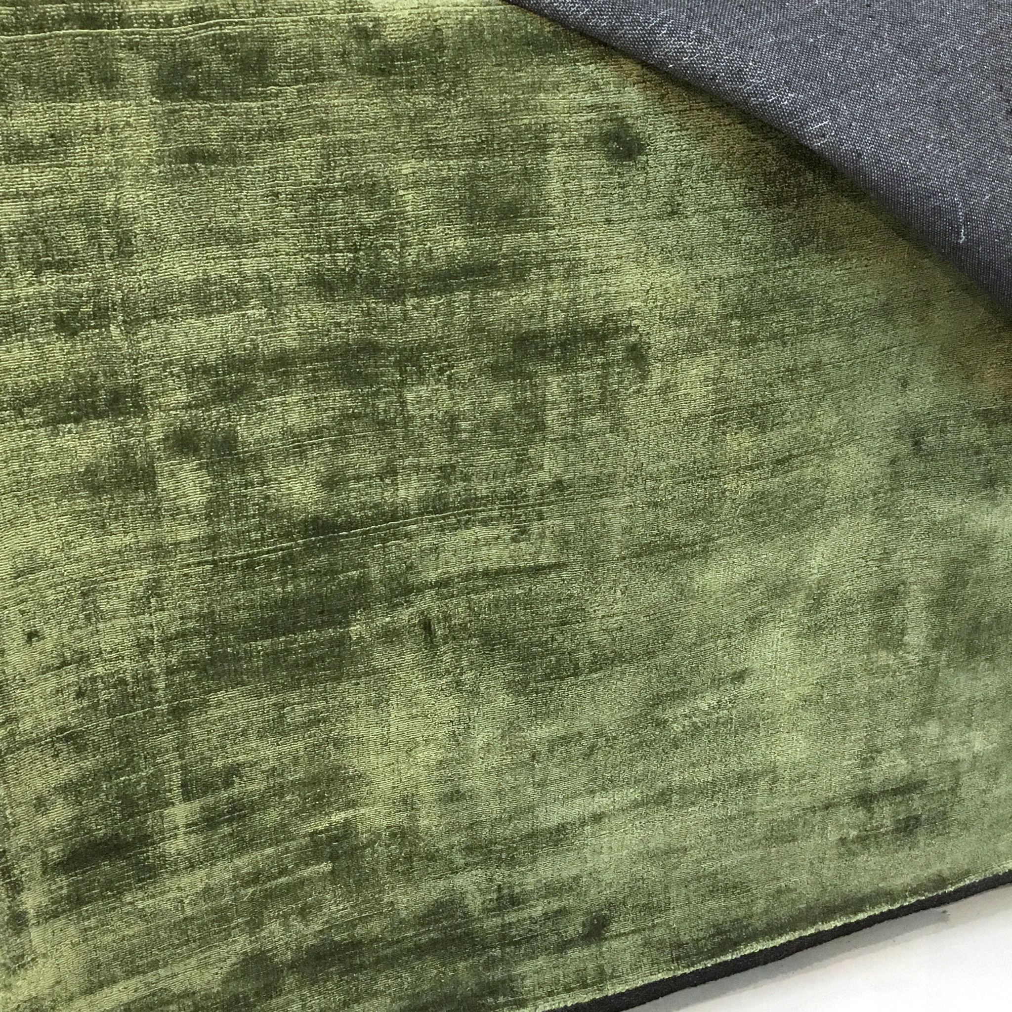 Large green luxurious rug