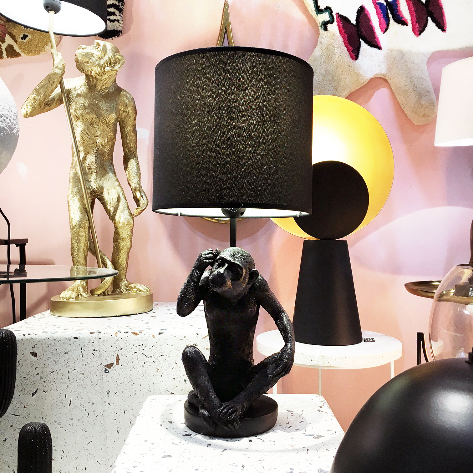 Black table lamp in the shape of a monkey
