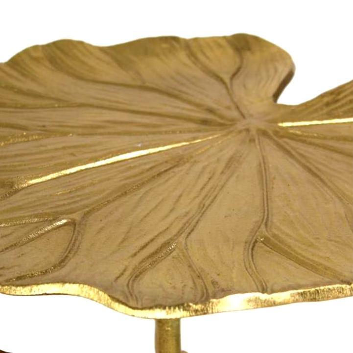 Gouden bijzettafel in de vorm van een monstera