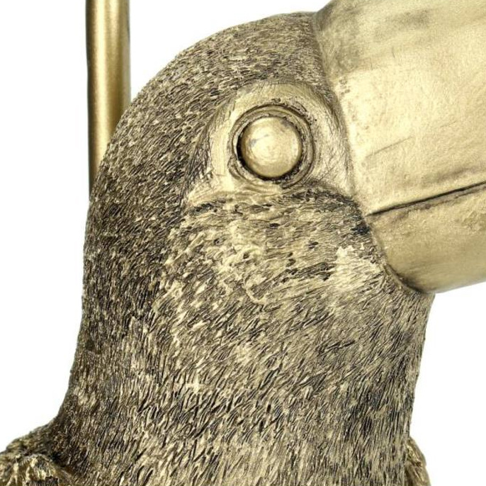 Gold toucan table lamp