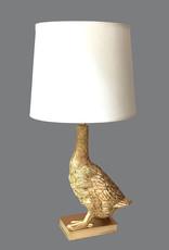 Gouden tafellamp in de vorm van een eend