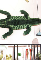 Large crocodile rug from Doing Goods