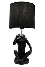 Zwarte tafellamp in de vorm van een aap