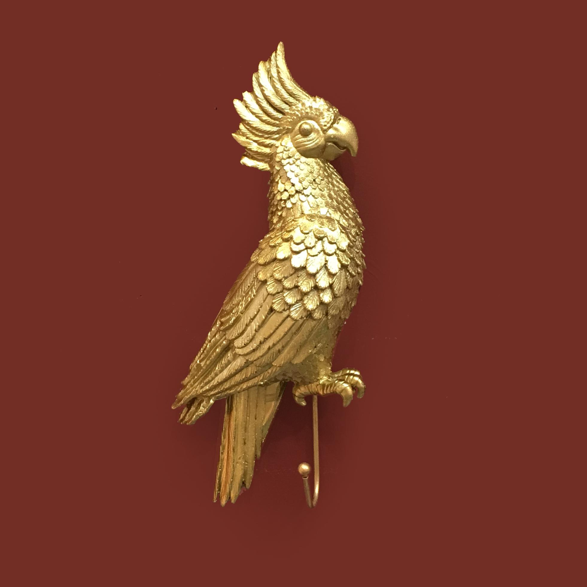 Jashaak in de vorm van een gouden kaketoe