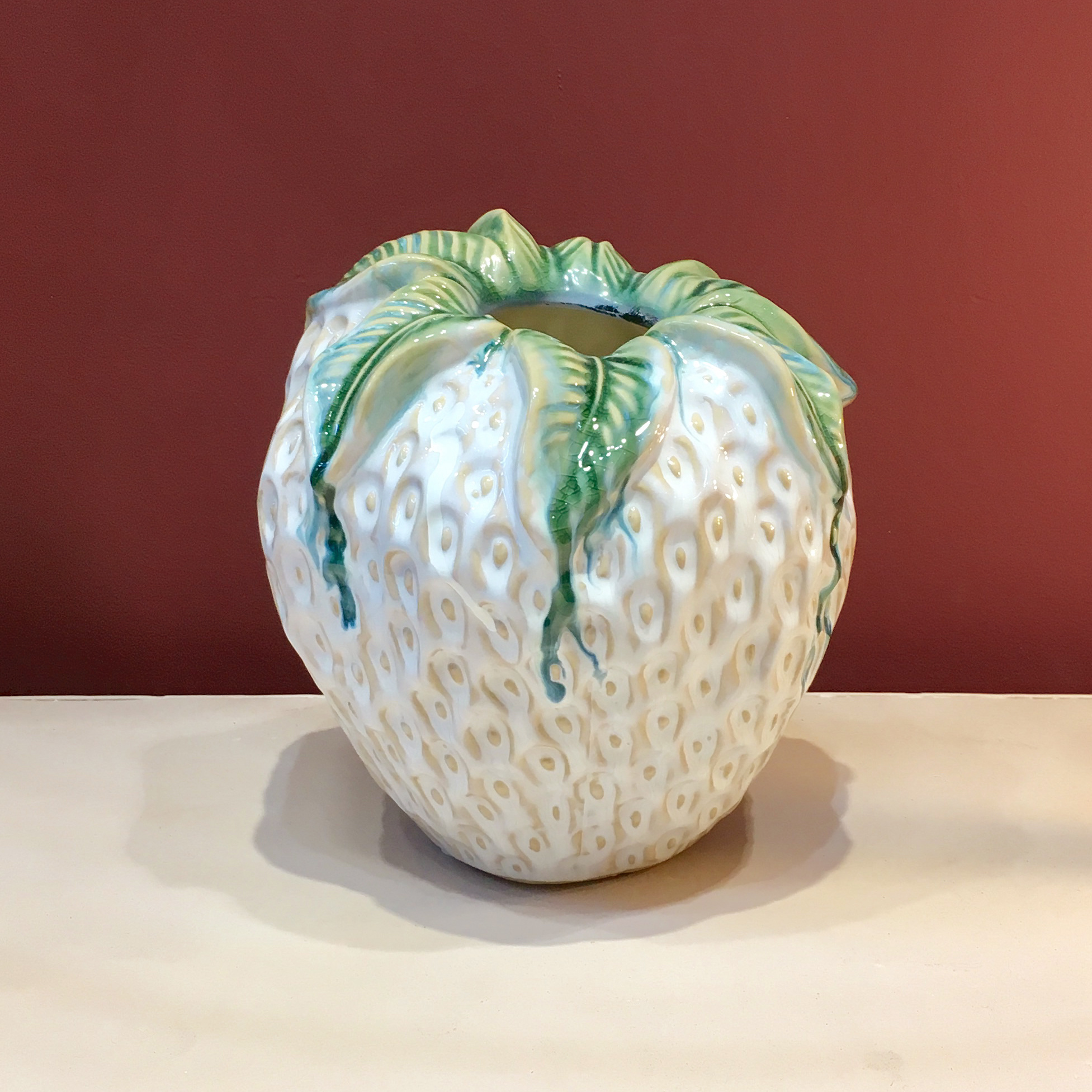 White ceramic strawberry vase