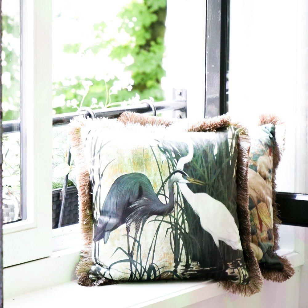 Velvet cushion with crane bird print and fringes