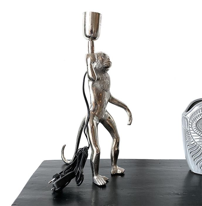 Aap tafellamp van zilverkleurig metaal