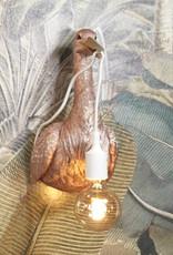 Design wandlamp in de vorm van een ooievaar