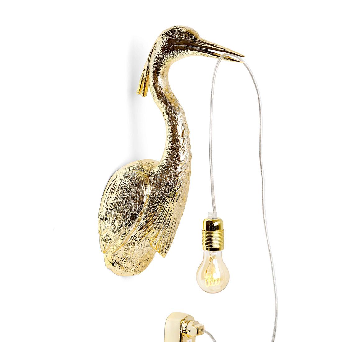 Gouden wandlamp in de vorm van een reiger