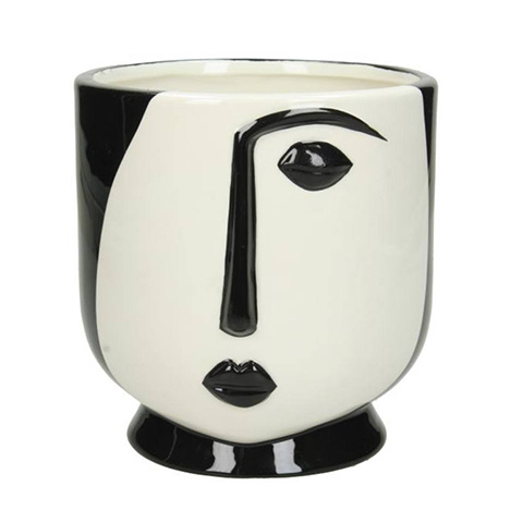 Modern planter with black and white face portrait