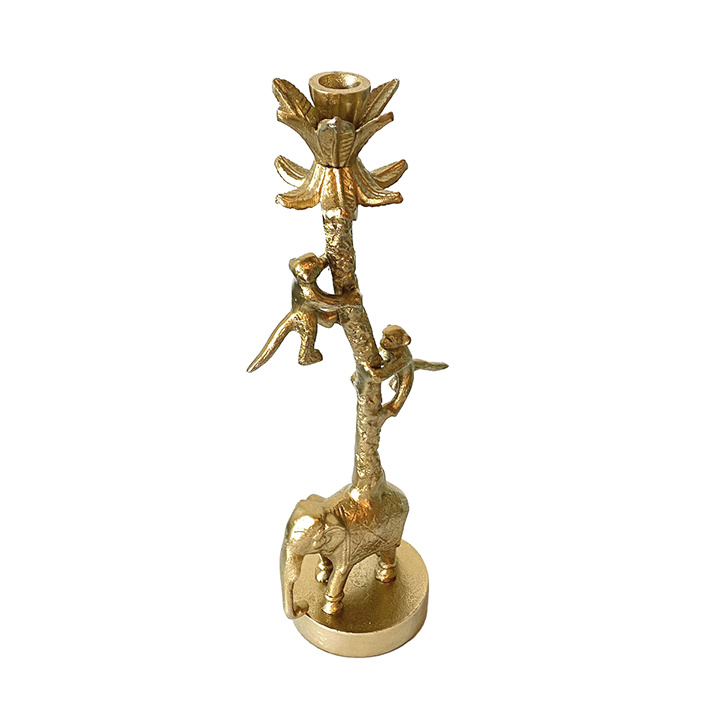 Gold metal candlestick with animals