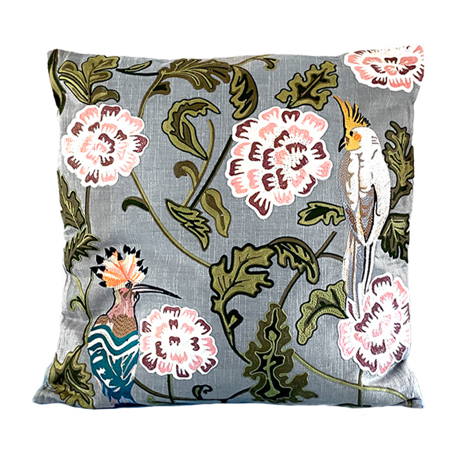 Cushion with embroidered birds