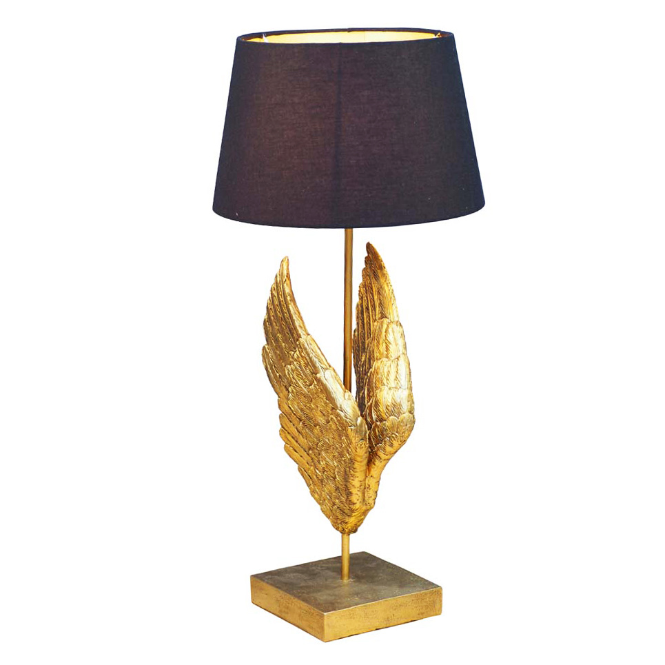 Table lamp with golden wings and black shade