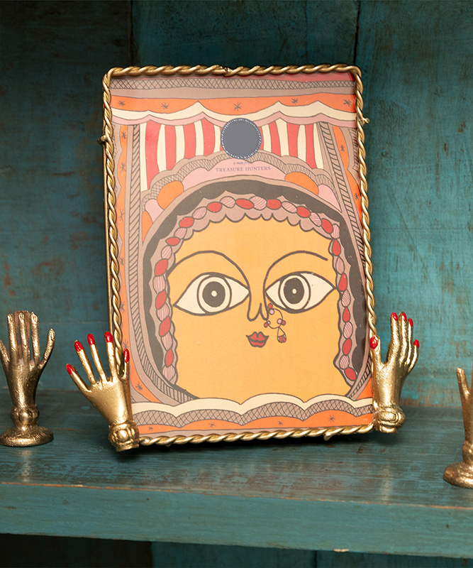Gold picture frame with hands