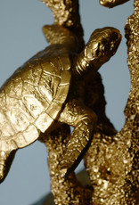 Gold table lamp with turtles