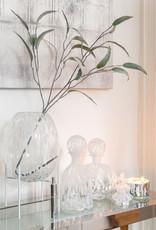 Glazen vaas met witte stippen op houder