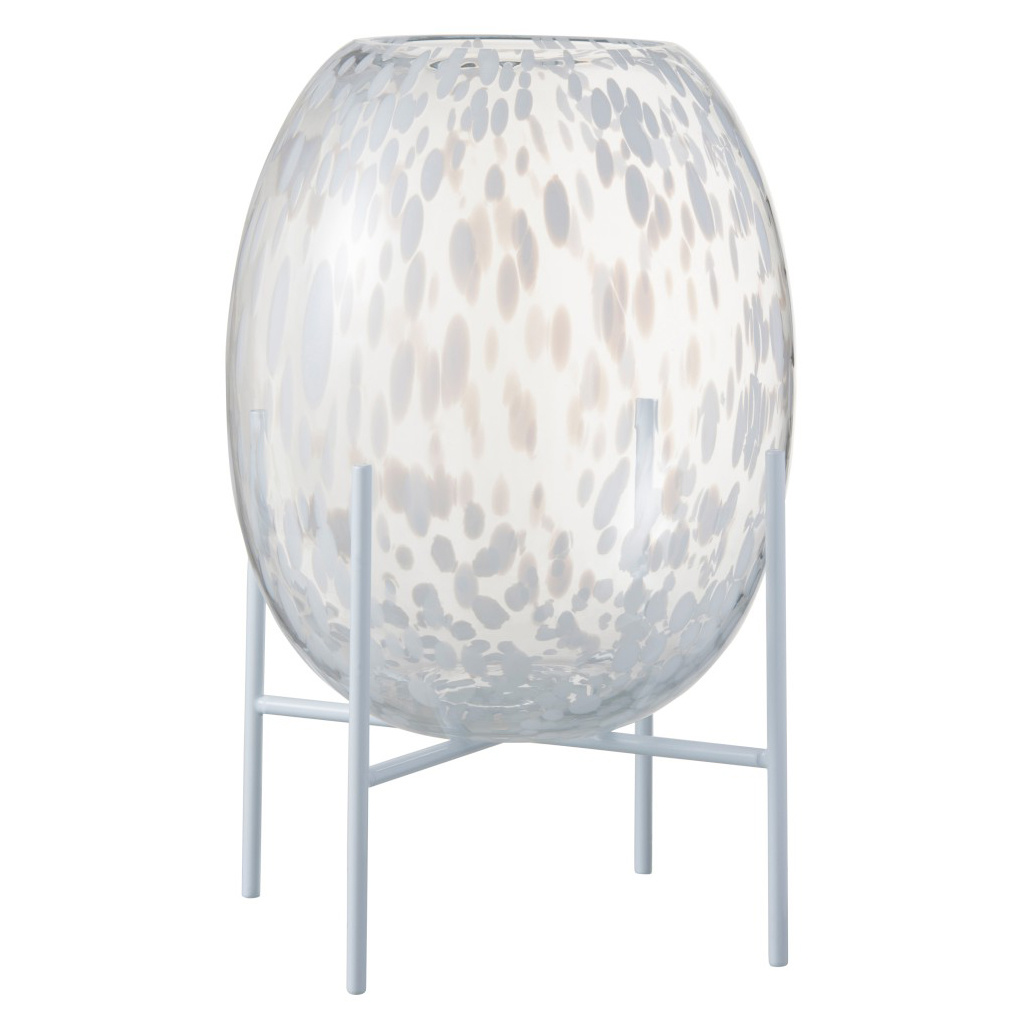 Glass vase with white dots on a stand