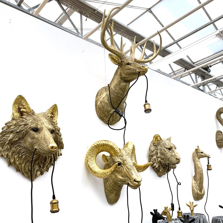 Gold wolf head wall light