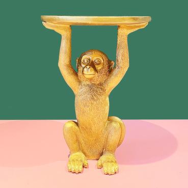 Hippe design bijzettafel in de vorm van een gouden aap