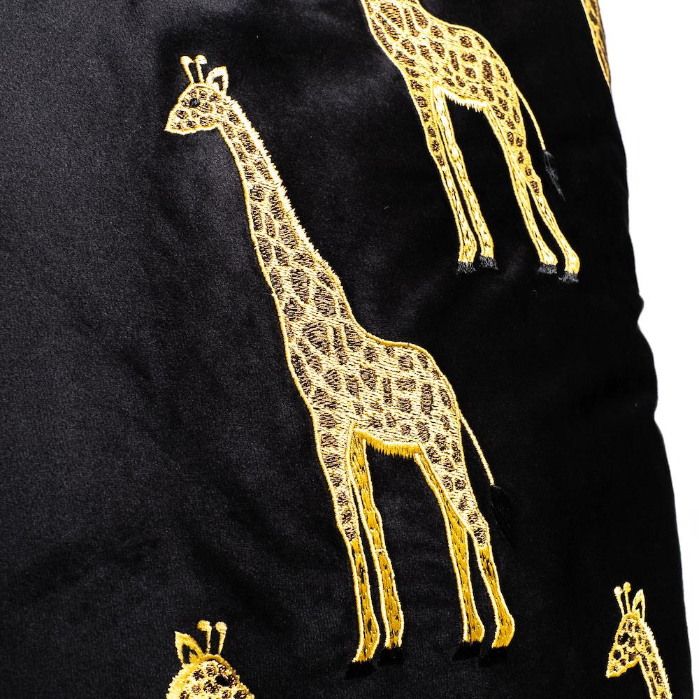 Black velvet sofa cushion with gold giraffes