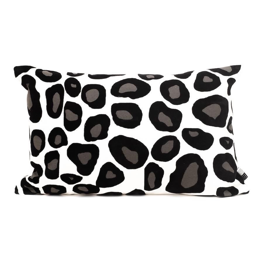 White rectangular sofa cushion with leopard print