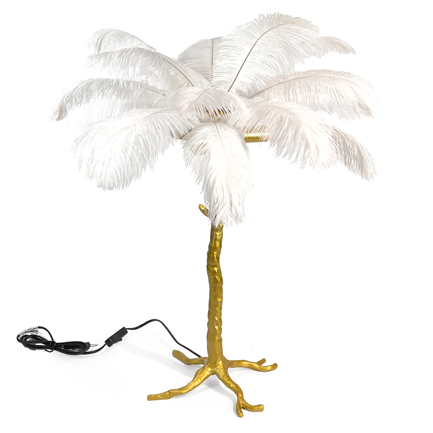 Gold table light with white feathers