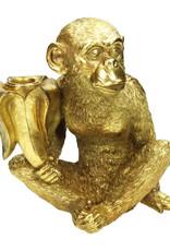 Gouden aap met banaan kandelaar