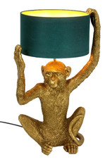Gold monkey table light with green lamp shade