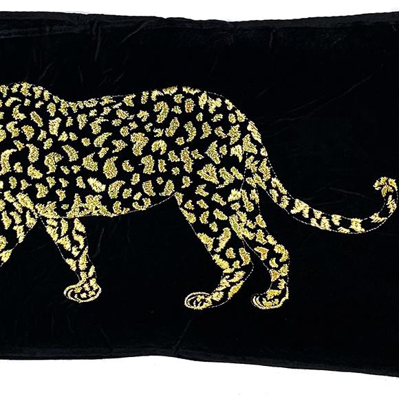 Black velvet sofa cushion with gold leopard decoration