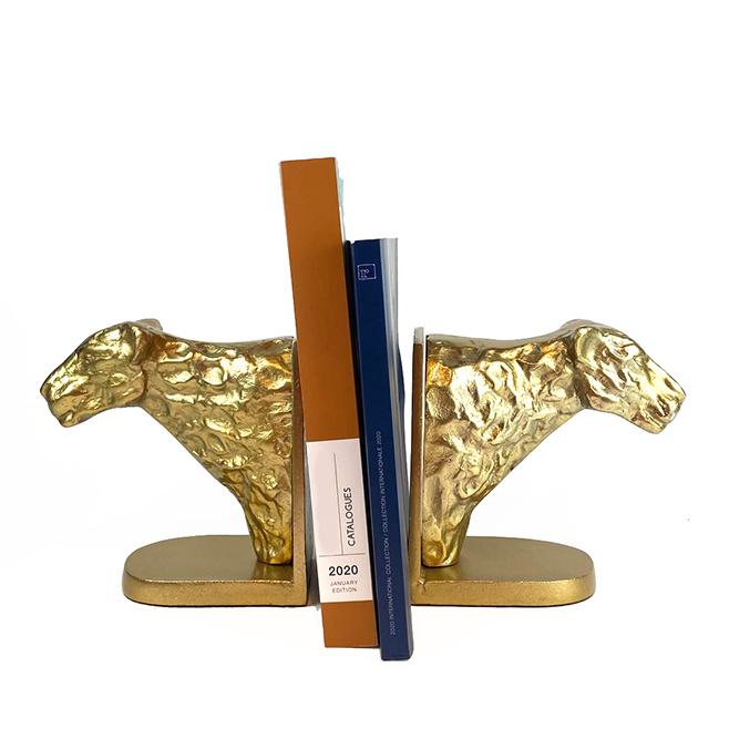 Gold metal leopard book ends set