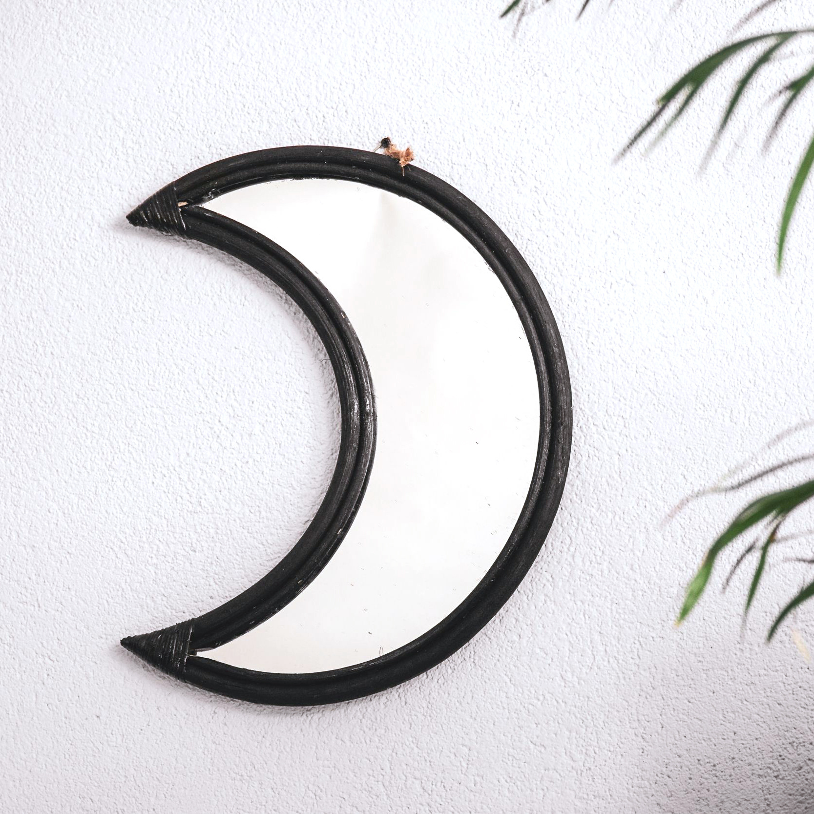 Black half moon rattan mirror