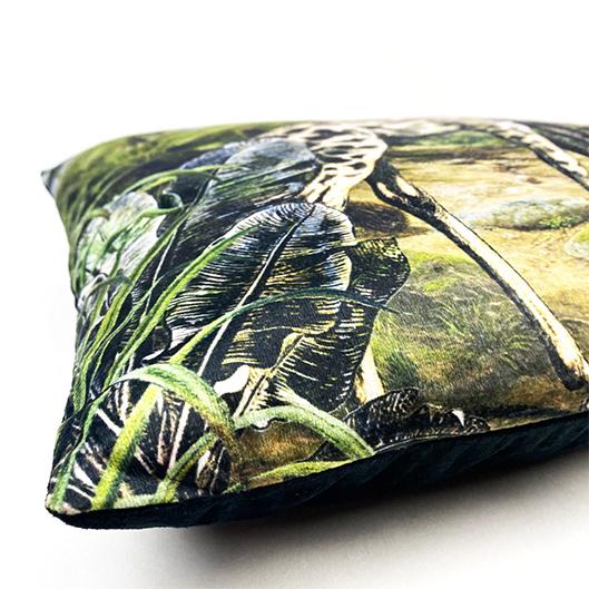Black sofa cushion with giraffes print