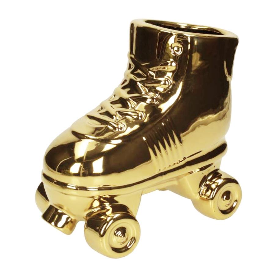 Gouden rolschaats bloempot of vaas