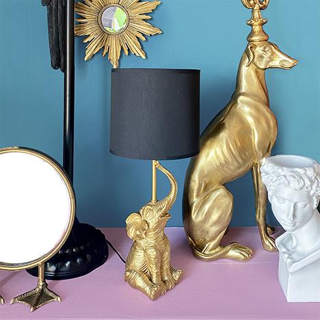 Gouden greyhound kandelaar