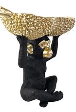 Zwarte aap met schaal decoratie