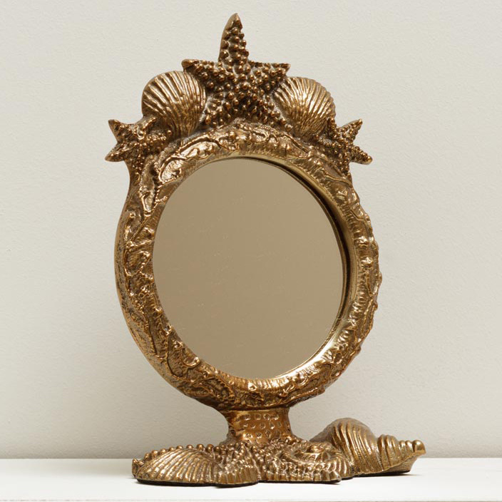 Gold table mirror with shell decoration