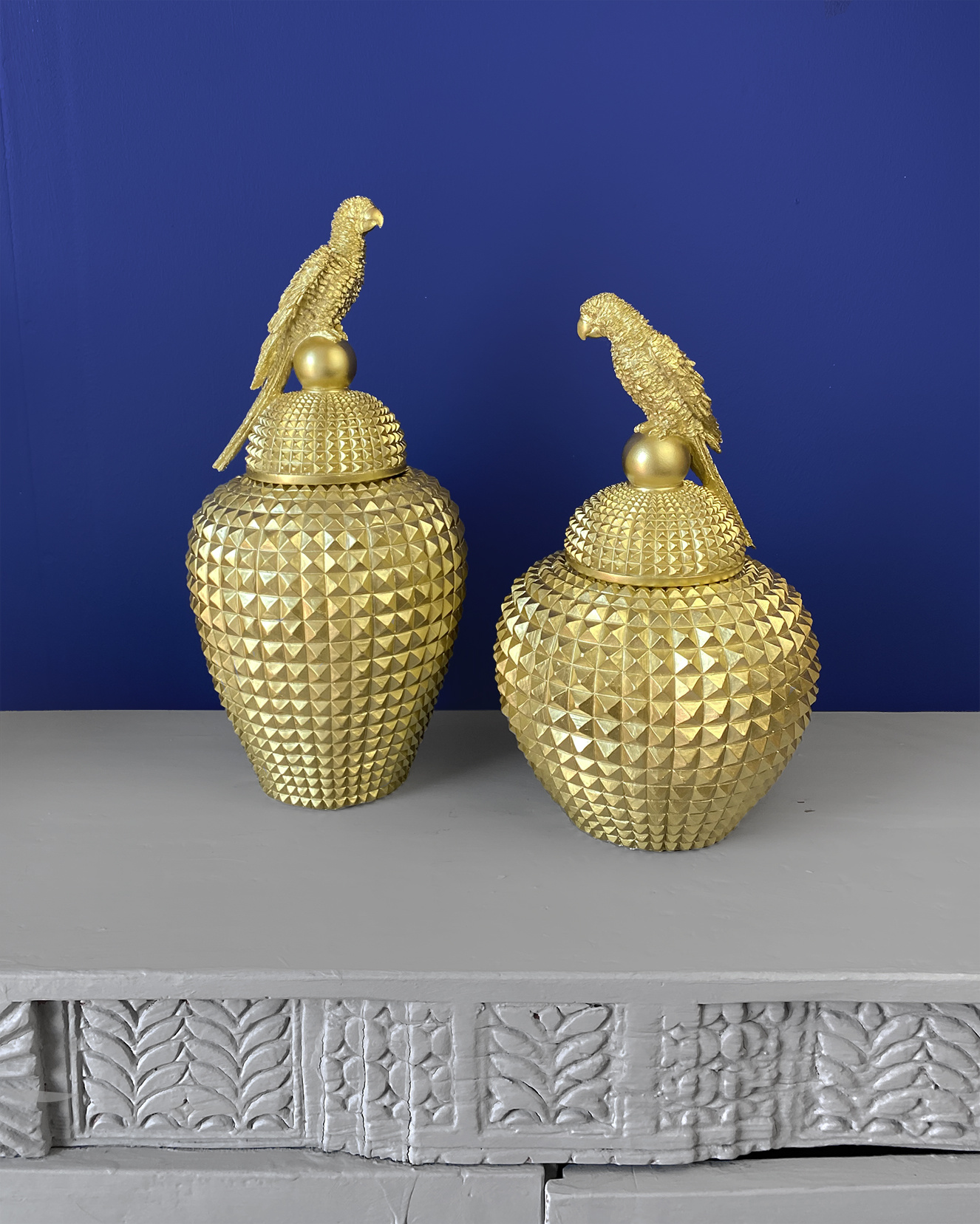 Gold container with parrot decoration